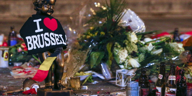 A replica of the Manneken-Pis statue, a major Brussels tourist attraction, is seen among flowers at a memorial for the victims of bomb attacks in Brussels metro and Brussels international airport of Zaventem, in Brussels