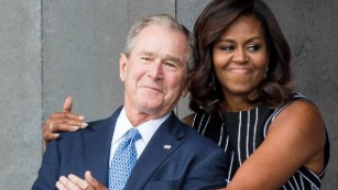 160924185453-michelle-obama-george-w-bush-hug-sept-24-medium-plus-169